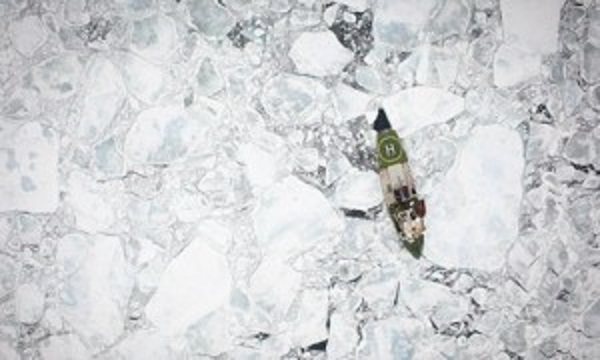 US Navy predicts summer ice free Arctic by 2016 Greenpeace icebreaking ship, Arctic Sunrise, among broken floes of Arctic sea ice, photographed from the air. This image was taken in the Fram Strait. Good to see Greenpeace doing their bit to create more open water.