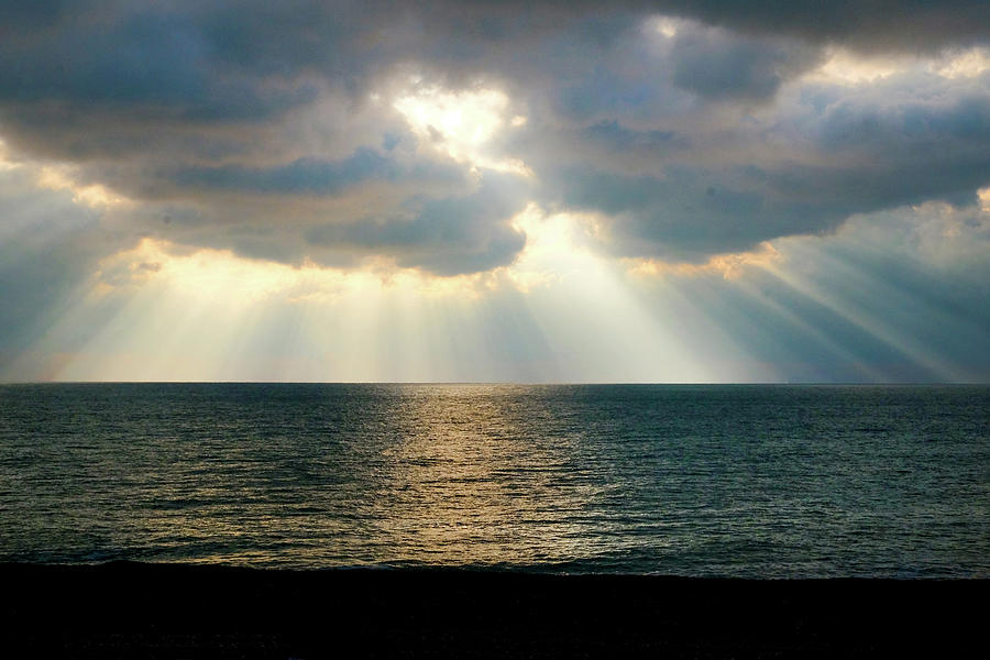 2-beams-of-sunlight-rays-shining-through-dramatic-clouds-onto-the-gill-copeland