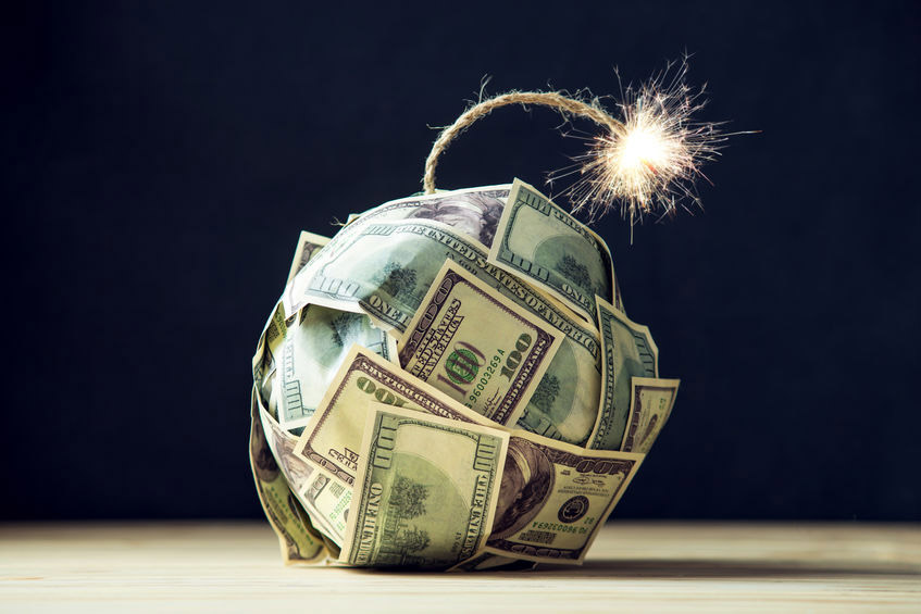 Bomb of money hundred dollar bills with a burning wick. Little time before the explosion. Concept of financial crisis